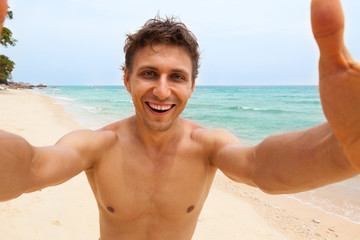 Tourist man beach taking selfie photo picture happy smile