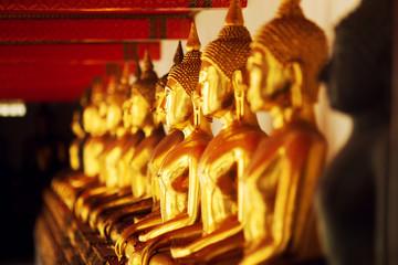 Golden Buddha statues at Wat Arun, Bangkok Thailand