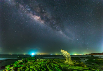 Milky Way in Ancient stone park on a summer night at 2 am,  galaxies stretching giving shimmering sky in the night, beneath a rock galaxies toward accent for photos