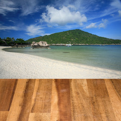 Wood table top on seascape background montage concept