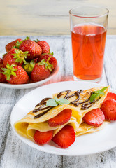 Pancakes with sliced strawberries