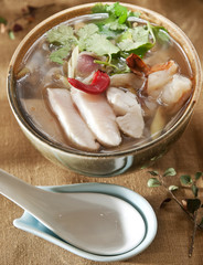 Tom Yum Goong or spicy tom yum soup with shrimp. Thai popular food menu, contained in bowl.