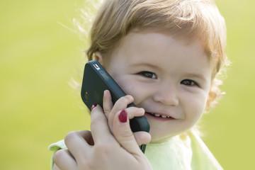 Little boy speaking on phone