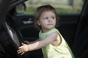 Curious little driver in car