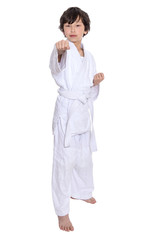 young asian boy isolated on white in judo clothing doing martial arts
