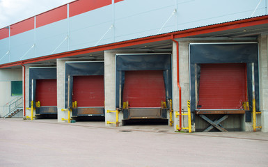 Warehouse with four red sliding gates.