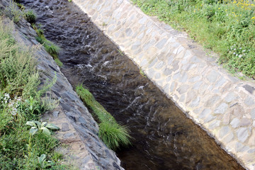 The flow of the water in the drainage canal