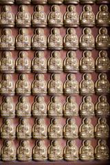 small image buddha on wall