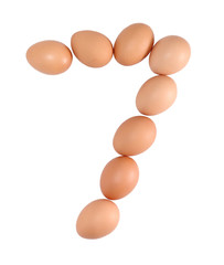 Number seven made of Eggs. Isolated on white.