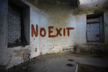 text no exit on the dirty old wall in an abandoned ruined house