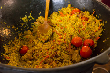 Rice Dish Made with Fresh Vegetables in Large Pot