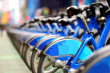 Row of city bikes for rent at docking stations