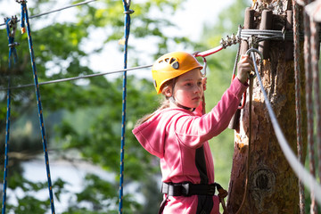 teenager climbing a rope park, Girl climbing in adventure park