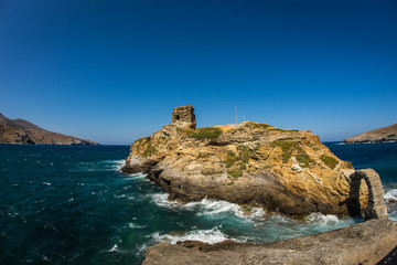 Ancient bridge to small island near the town of Andros, Andros,