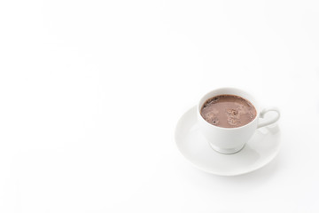 a cup of chocolate on white