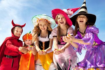 Five Halloween Children Holding Candies