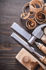 Planer claw hammer flat chisels and wooden curled shavings on vi