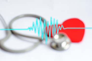 Heartbeat on blur Stethoscope with red heart background - Health
