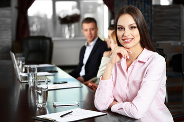Businesswoman and business people working in conference room