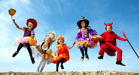 Five Halloween Children Jumping at the Blue Sky.