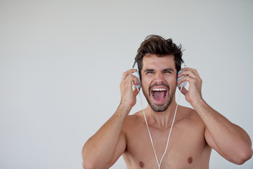 handsome young man listening music on headphones