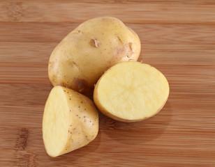 potato over wooden background