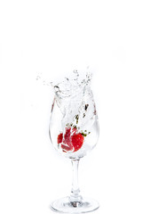Strawberry in wine glass  on a white background