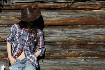 young girl in a cowboy hat