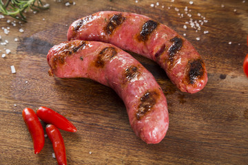 grilled meat sausages with potatoes and tomatoes
