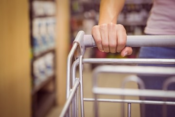 Hand of woman putting on trolley
