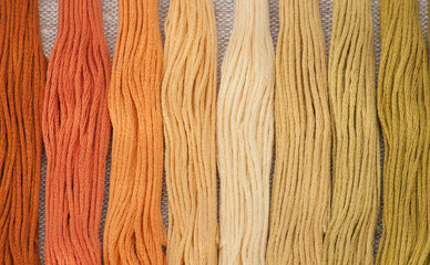 Colorful Threads Set. Natural Linen Background