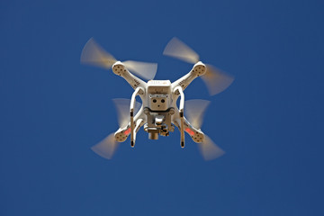 Quadrocopter Drone - UAV - flying in the sky - camera