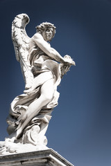 Angel with Thorn Crown statue, Sant Angelo bridge, Rome. A detail view of one of the statues which adorn the Sant Angelo Bridge, Rome, Italy.