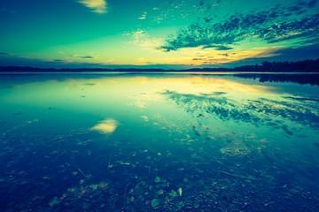 Vintage photo of beautiful lake sunset