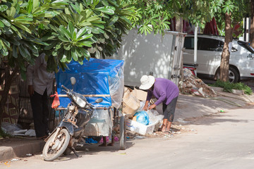 Cambodian family searching for food in the rubbish