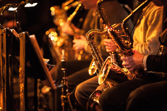 Big Band saxophone section. A candid view along the saxophone section of a big band in concert.