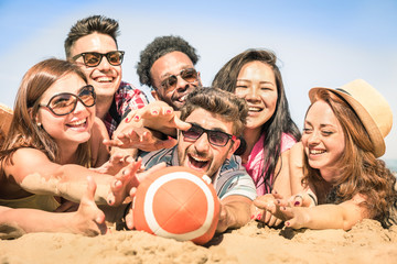 Group of multiracial happy friends having fun at beach games