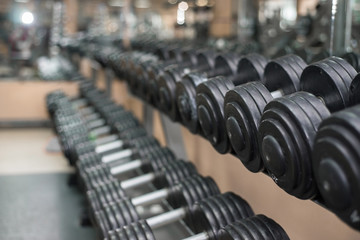 dumbbells on a background of the gym.