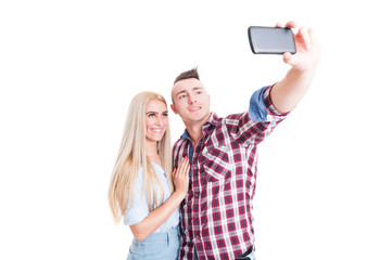 Beautiful young couple taking a selfie using phone