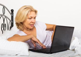Girl with laptop laying