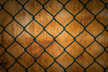 Wall Mural - Steel mesh fence with rust  background