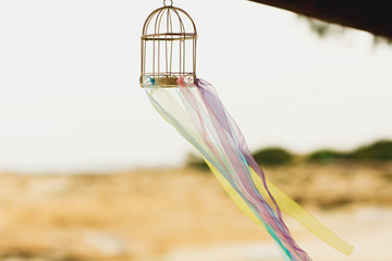 stylish hawaiian colorful decorated birdcage with ribbons on cyprus