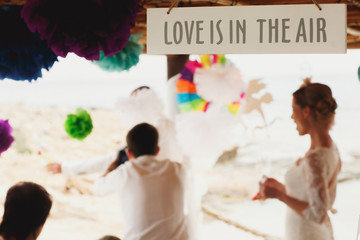 beautiful sign love is in the air, hawai  colorful sand ceremony  on cyprus