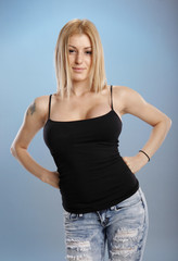 Attractive blond in jeans and tank top