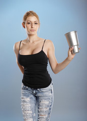 Young woman in jeans handles a drink