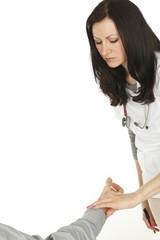 Nurse taking patient's pulse.