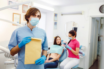 dentist with documents in hands