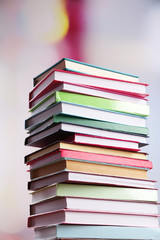 Stack of books on bright background