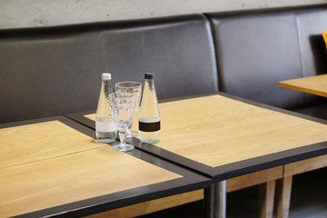 Empty glasses and bottle of mineral water in restaurant