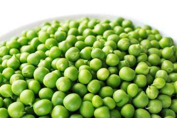 Fresh green peas in bowl close up